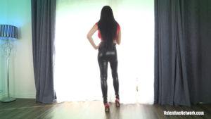 Skyla Novea wearing latex pants and high heels